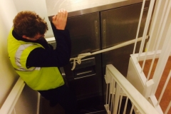 american fridge freezer on the stairs
